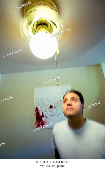 Young man posing in his apartment