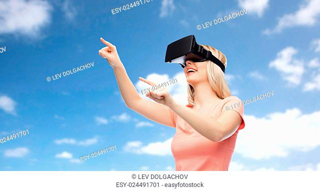 technology, virtual reality, entertainment and people concept - happy young woman with virtual reality headset or 3d glasses over blue sky and clouds background