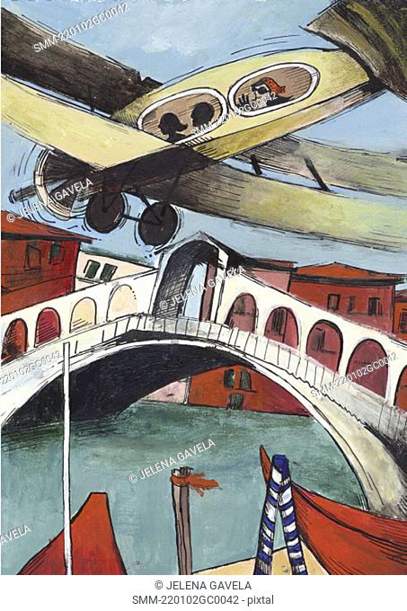 Tourists in small plane flying over Rialto Bridge at Venice's Grand Canal