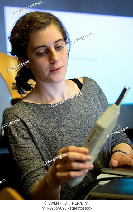 Christina Varvia of the research groupo Forensic Architecture at the University of London holds up a volume measuring device at a press conference of the...