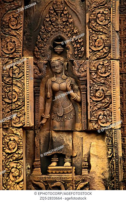 Devata carving, Banteay Srei temple, Angkor, Cambodia. The citadel of women, this temple contains the finest, most intricate carvings to be found in Angkor