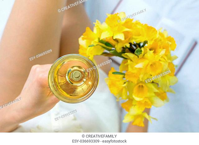 Woman with narcissus flower in bed