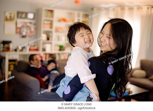 USA, Young woman carrying daughter (2-3)