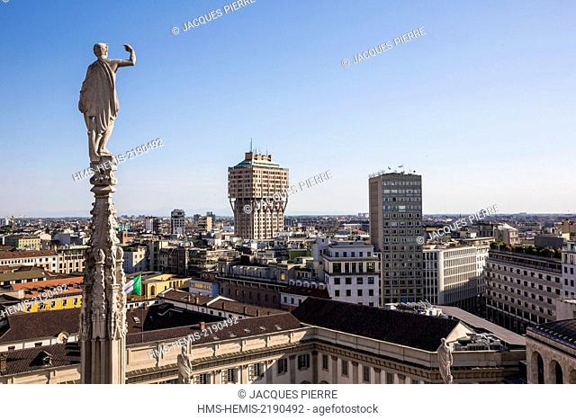 Italy, Lombardy, Milan, one arrow and statue of Duomo seen since the terrace situated on the roof of the cathedral with a view of the tower Velasca