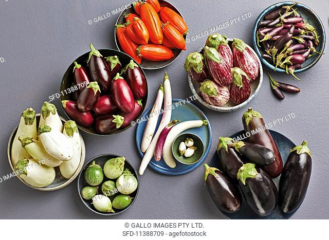 Various sizes and colours of aubergines