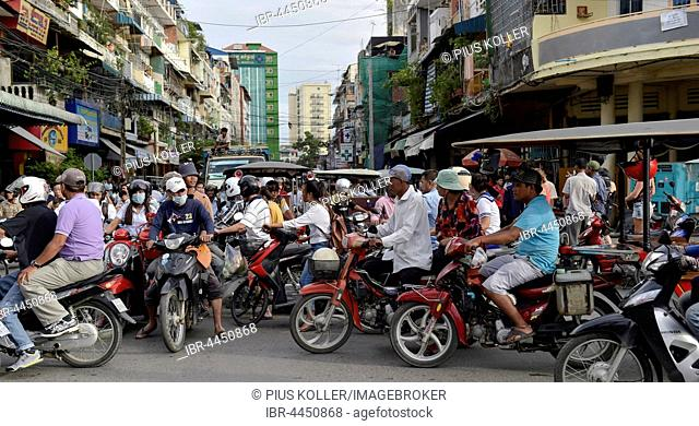 Traffic, many mopeds at an intersection, Phnom Penh, Cambodia