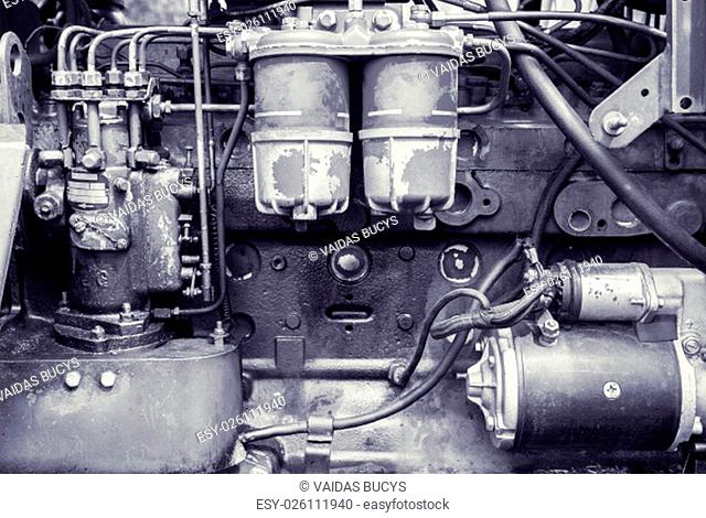 Colored background of an old oily weathered engine