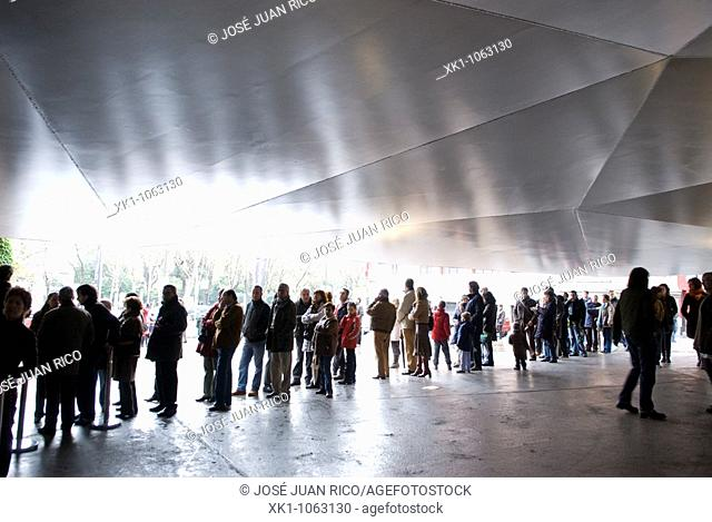 People queuing at the entrance of Caixaforum. Madrid, Spain
