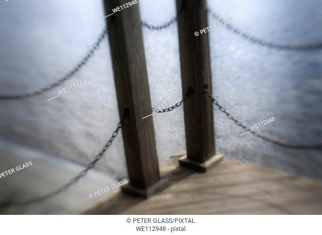 Wooden beams and metal chains from a pier