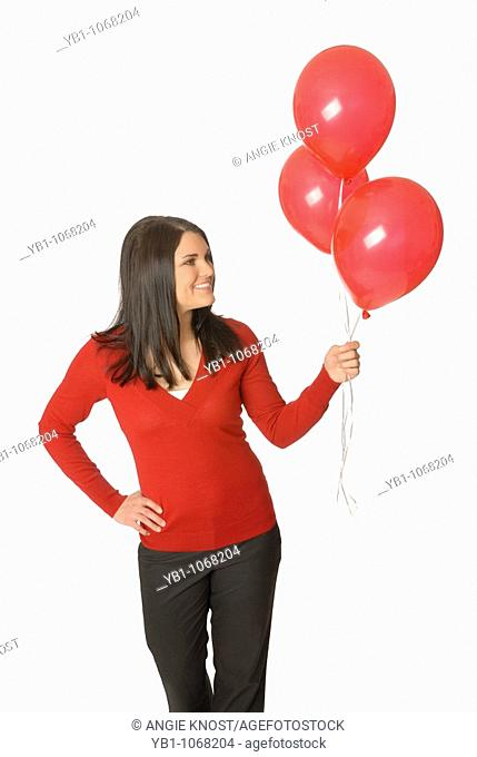 Attractive woman with red balloons