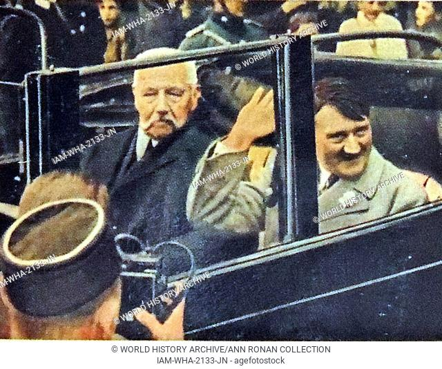 President Paul Von Hindenburg and Adolf Hitler riding in a car after Hitler was appointed Chancellor in 1933