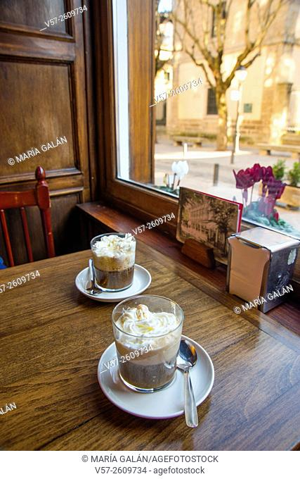 Two Irish coffees in a traditional cafe. San Lorenzo del Escorial, Madrid province, Spain