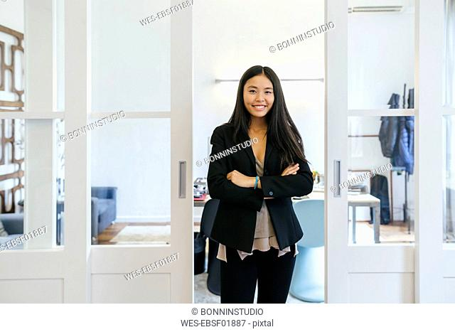 Confident businesswoman standing in office