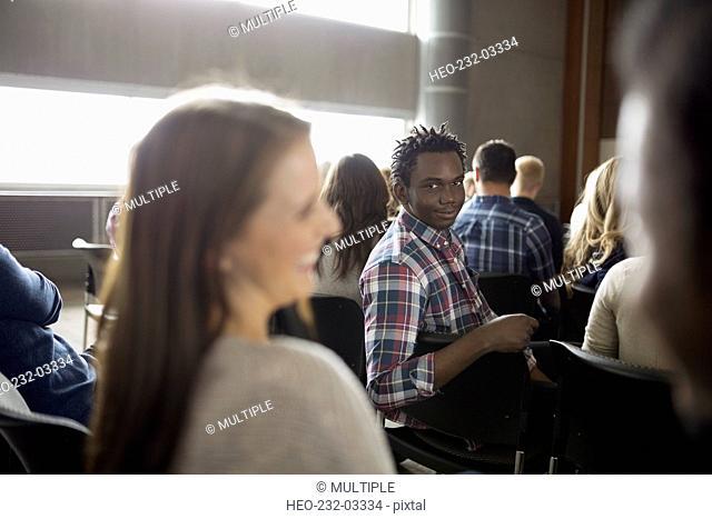 Portrait confident man in auditorium audience