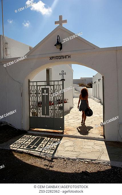 Woman at the entrance of the Chrisopigi monastery, Sifnos, Cyclades Islands, Greek Islands, Greece, Europe