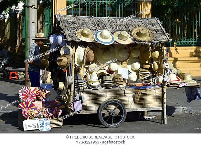 Man selling straw hats in Phnom Penh,Cambodia,South east Asia