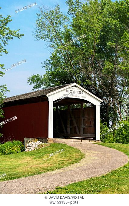The Neet Covered Bridge crosses Little Raccoon Creek on County Road South 80 East in Parke County Indiana, USA. This single span Burr Arch Truss structure has a...