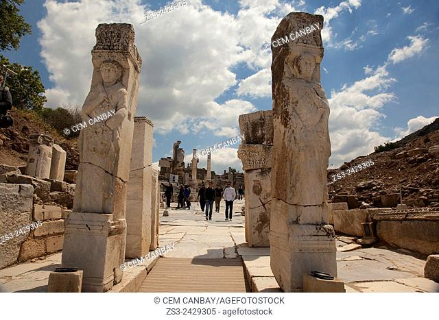 Pillars with reliefs depicting slaves at the Street of Curetes in the Roman ruins of Ephesus, Efes, Selcuk, Kusadasi, Turkey, Europe