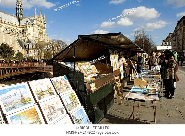France, Paris, Quai de Montebello, secondhand booksellers and Notre Dame de Paris cathedral