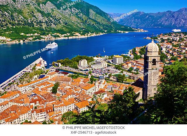 Montenegro, Adriatic coast, Bay of Kotor, Kotor, Elevated view over the Old Town, fjord and mountains from the walls of the Kotor Fortress which forms a...