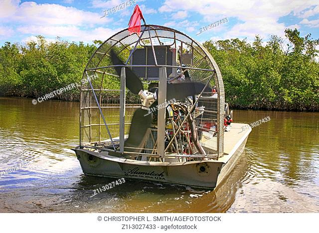 People aboard an airboat in the mangrove swamp around Everglades City in South Florida USA