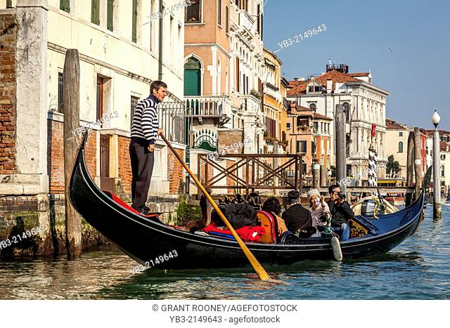 Tourists Taking A Gondola Ride, The Grand Canal, Venice, Italy