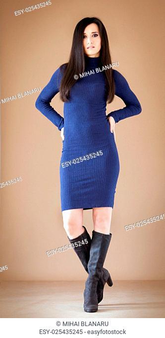 Studio portrait of a lovely brunette posing