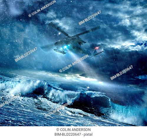 Helicopter flying over stormy seas