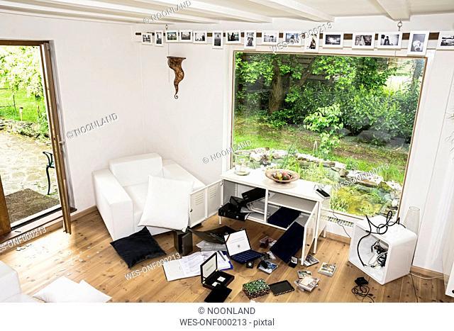 Germany, North Rhine Westphalia, Interior of living room after burglary