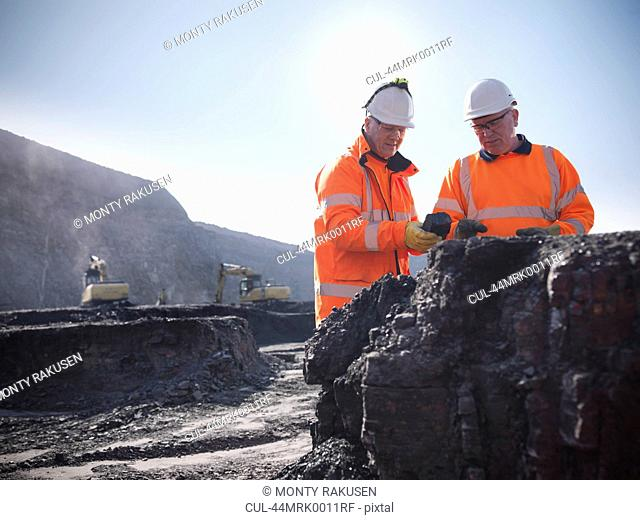 Workers inspecting coal at mine