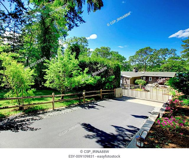 Beautiful home with private gates, driveway and garden