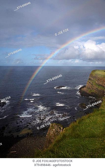 rainbow over cliffs on the north antrim causeway coastal route county antrim northern ireland uk