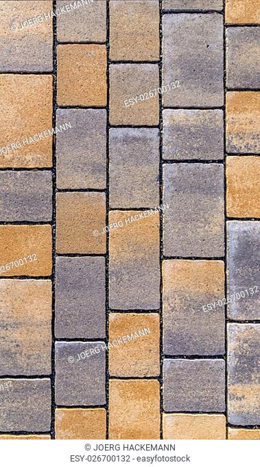 red Paving blocks made of square stone in bright ligh