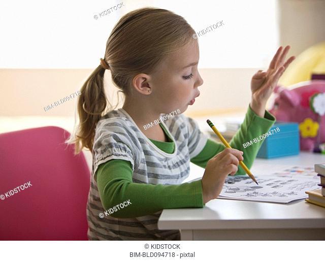 Caucasian girl doing math homework