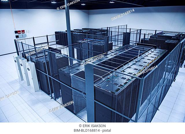 High angle view of technology in server room cage