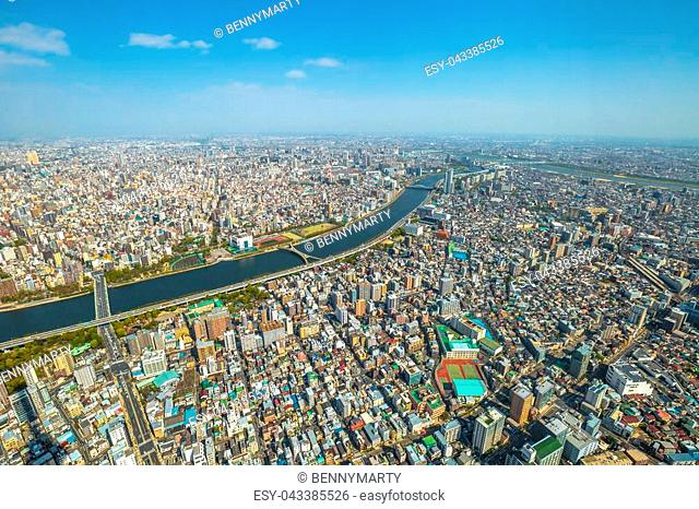 Aerial view of Tokyo city skyline, Sumida River Bridges and Asakusa area from Tokyo Skytree observatory. Daytime. Tokyo, Japan