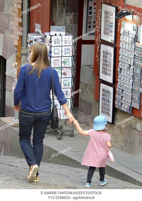 Woman Walking With Resistant Child, Saint-Jean-Pied-de-Port, France