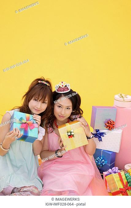 Portrait of teenage girls with gift boxes