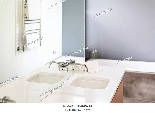 Modern, minimalist home showcase interior bathroom sink and mirror