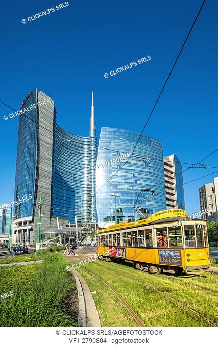 Milan, Lombardy, Italy. Iconic tramway with Porta Nuova business district in the background