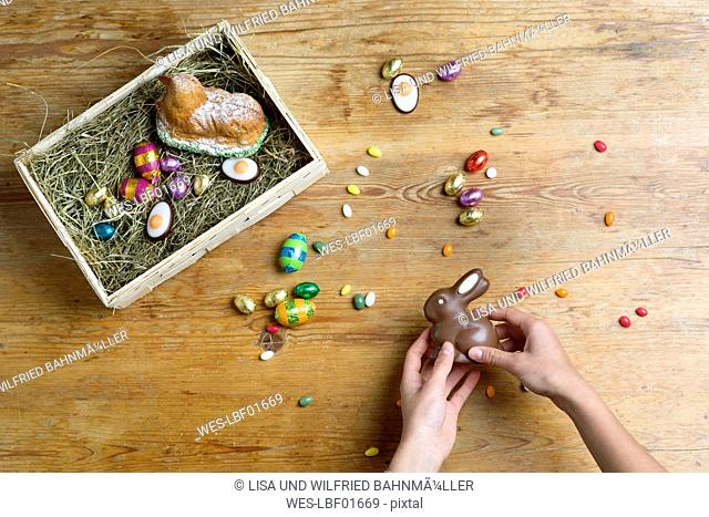 Hands filling Easter nest