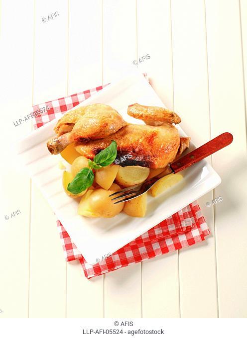 Roast chicken and new potatoes - overhead