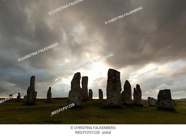 UK, Scotland, Isle of Lewis, Callanish, view to formation of standing stones at backlight