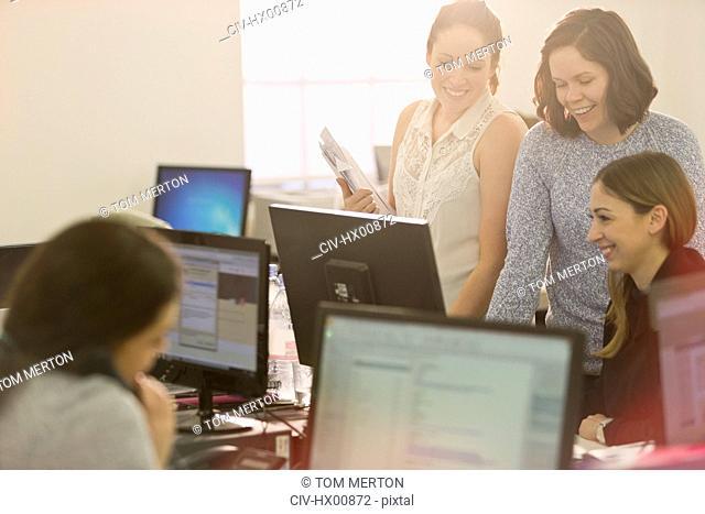 Businesswomen meeting at computer in office