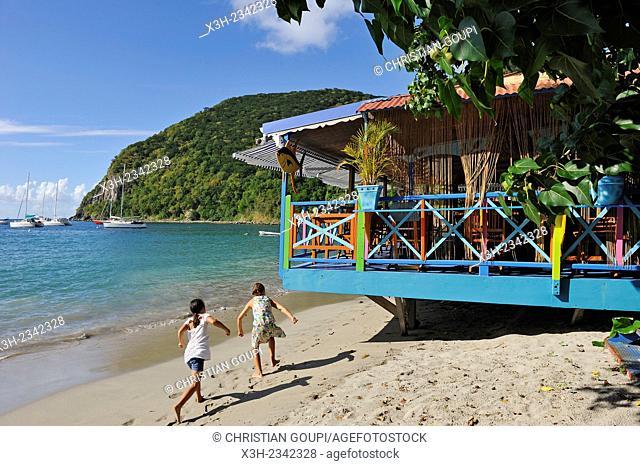 cafe restaurant terrace on stilts, village of Deshaies, Basse-terre, Guadeloupe, overseas region of France, Leewards Islands, Lesser Antilles, Caribbean