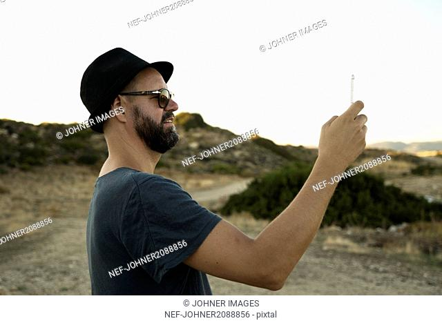 Man taking photo with cell phone