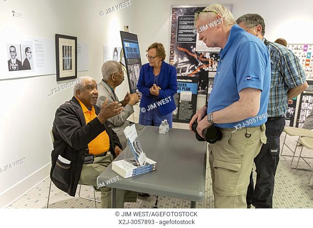 Montgomery, Alabama - Freedom Riders Bernard Lafayette (left) and Rip Patton talk with visitors to the Freedom Rides Museum