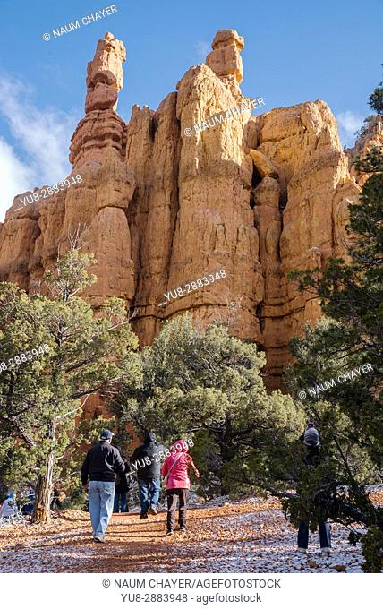 Group of tourists near famous Hoodoos mountain, Red Canyon, Utah, USA