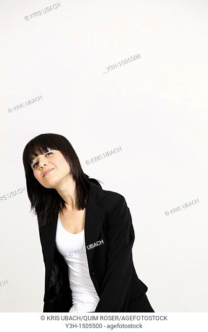 Studio shot of young Italian woman, looking at camera