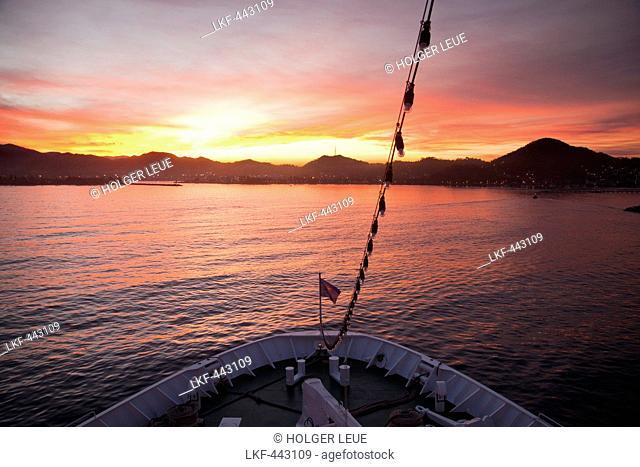 Bow of cruise ship MS Deutschland (Reederei Peter Deilmann) and coastline at sunrise, Manzanillo, Colima, Mexico